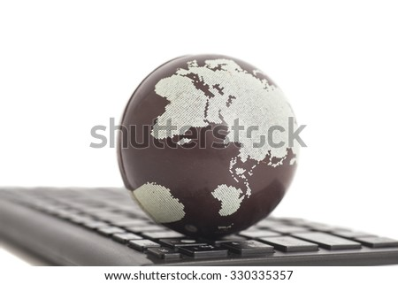 Earth on keyboard isolated on white