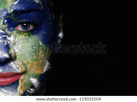 Earth painted on woman face. Elements of this image furnished by NASA - stock photo