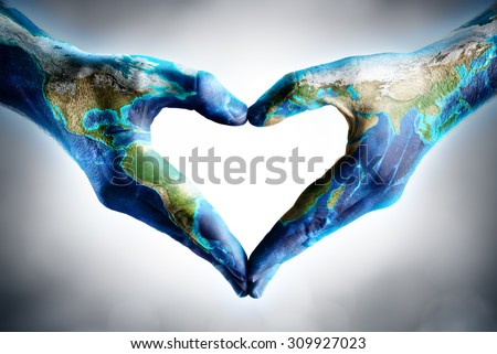 earth's day celebration - hands shaped heart with world map - elements of this image furnished by NASA