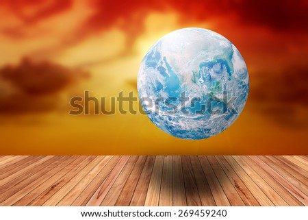 Earth's day theme with global and blur sunset with wood pave way Elements of this image furnished by NASA - stock photo