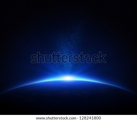 Earth - sunrise in deep blue space - stock photo