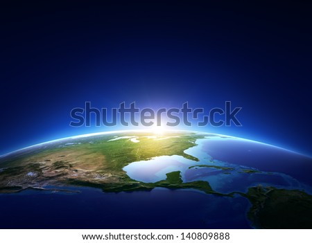 Earth sunrise over cloudless North America (Elements of this image furnished by NASA) - stock photo
