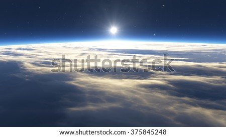 Earth sunrise with clouds, sun and stars - stock photo