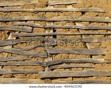 earth wall with wooden elements