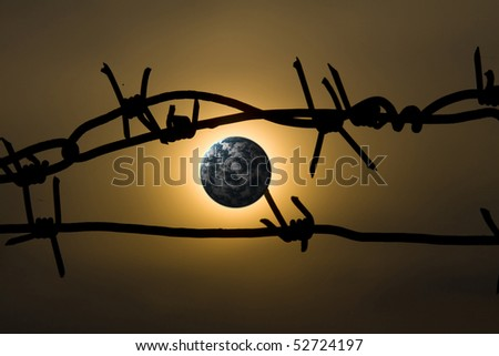 Earth with barbed wire, clipping path in prison. - stock photo