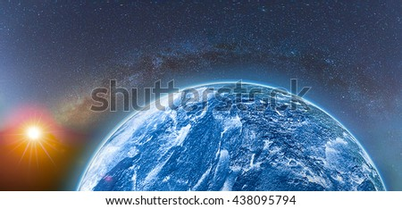 Earth with rising sun and clearly milky way. - stock photo