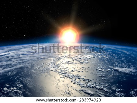 Earth with the rising sun. Elements of this image furnished by NASA - stock photo