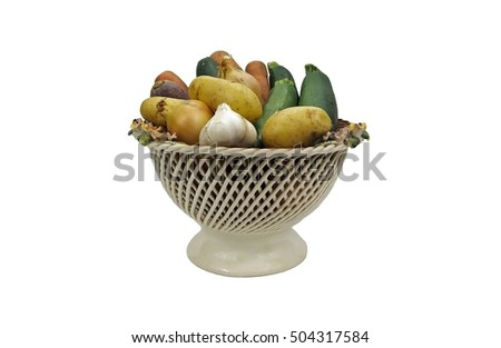 earthenware basket containing different vegetables