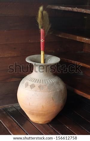 Earthenware keep the broom. - stock photo