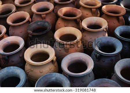 Earthenware Pottery is the art of handicrafts inThailand. - stock photo