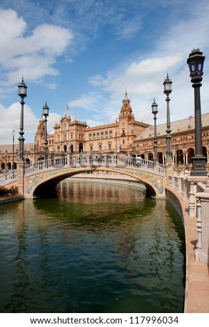 Earthenware small bridge on a canal, Plaza Espana, Seville, Spain. - stock photo