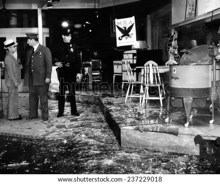 Earthquake Dam ages a store in the heart of Los Angeles A policeman guards an appliance store amidst broken glass There were no fatalities. - stock photo
