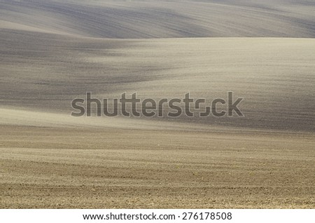 Earthy abstract natural agricultural  background with hills and waves - stock photo