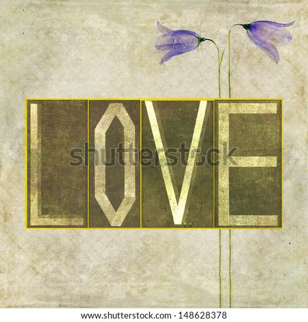 """Earthy background image and design element depicting the word """"Love"""" - stock photo"""