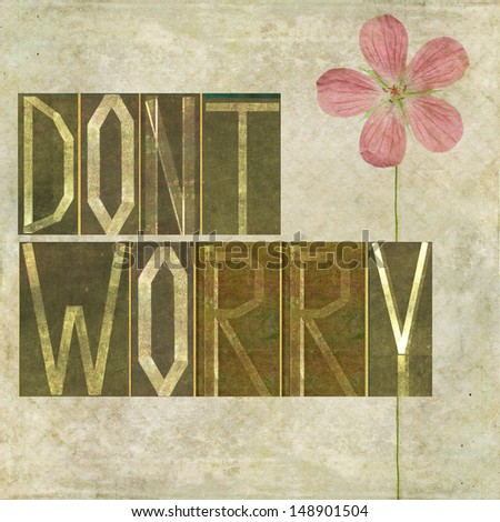 """Earthy background image and design element depicting the words """"Don't worry"""" - stock photo"""