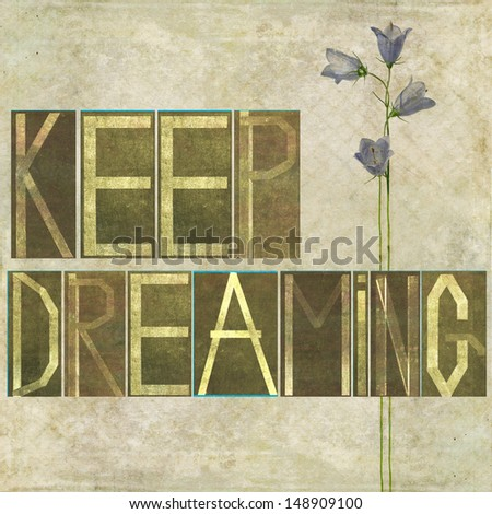"""Earthy background image and design element depicting the words """"Keep dreaming"""" - stock photo"""