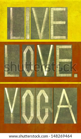 """Earthy background image and design element depicting the words """"Live Love Yoga"""" - stock photo"""