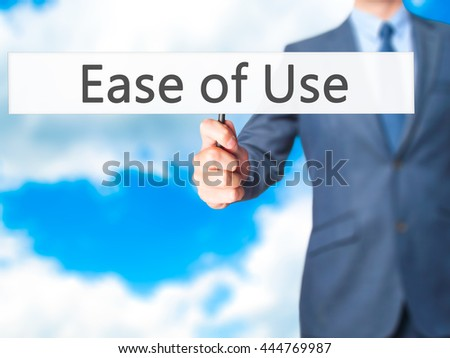 Ease of Use - Businessman hand holding sign. Business, technology, internet concept. Stock Photo