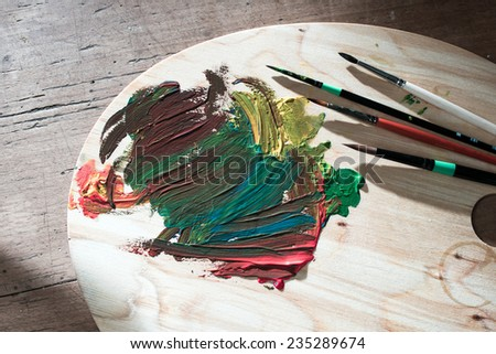 easel and paint brush - stock photo