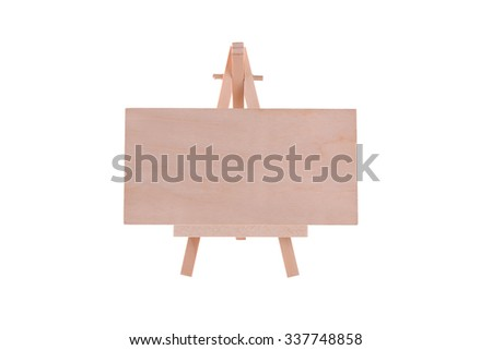 Easel with blank wooden panel in isolated and selective focus