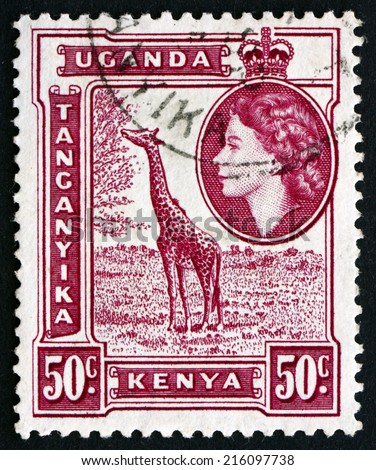 EAST AFRICAN POSTAL UNION - CIRCA 1954: a stamp printed in the East African Postal Union (Kenya, Uganda, Tanganyika) shows Giraffe, Giraffa Camelopardalis, circa 1954 - stock photo
