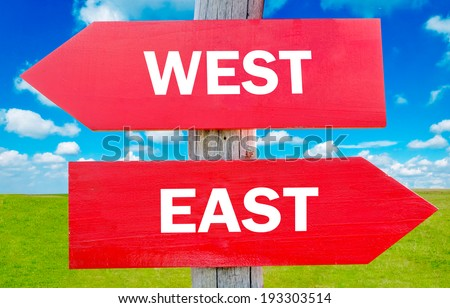 East and west choice showing strategy change or dilemmas - stock photo