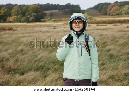 East Asian Woman hiking in the Richmond Park, London, UK.   - stock photo