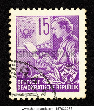 EAST GERMANY - CIRCA 1951: Stamp printed in East Germany with image of a female stenographer, circa 1951.