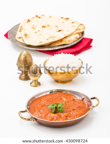 East Indian meal consisting of butter chicken, rice and nan bread. - stock photo