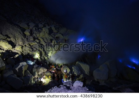 East Java, Indonesia - 4 May 2015: Exploring the Ijen blue fire, one of the rare phenomena on earth, at Ijen Crater - stock photo