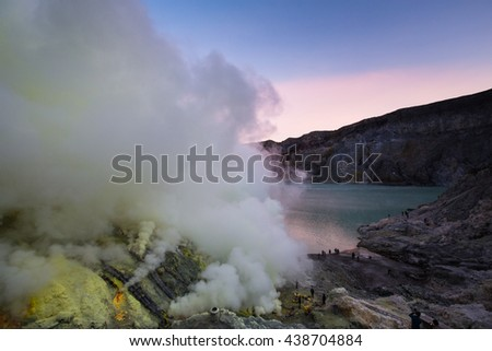 East Java, Indonesia - 4 May 2016: Exploring the local sulfur mine on top of Mt. Ijen & the crater - stock photo