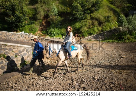 EAST JAVA,INDONESIA-MAY 04 : Tourists ride the horse to viewpoint on Mount Penanjakan,The best views from Mount Bromo and the surrounding volcanoes on May 04,2013 in East Java , Indonesia.