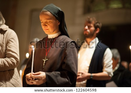 EAST JERUSALEM, PALESTINIAN TERRITORY - NOVEMBER 20: A Catholic nun holds a candle during a prayer service in the Basilica of St. Stephen, East Jerusalem, in solidarity with Gaza, November 20, 2012.