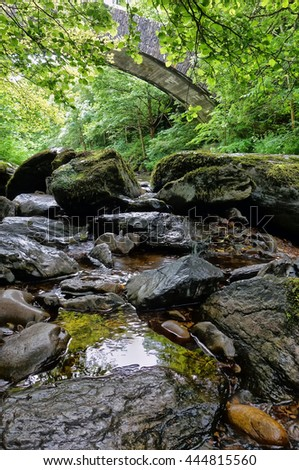 East Lyn River, Lynmouth, Exmoor, Devon, England. Showing the cascading water under a bridge                     - stock photo