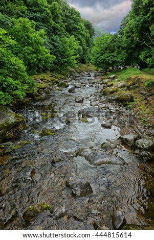 East Lyn River, Lynmouth, Exmoor, Devon, England. Showing the flowing water.. - stock photo