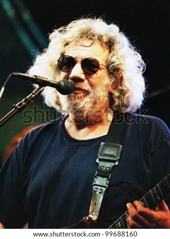 EAST RUTHERFORD, NEW JERSEY - AUGUST 3: The Grateful Dead in concert in East Rutherford, New Jersey, on Sunday, August 3, 1994.  Seen here is Jerry Garcia. - stock photo