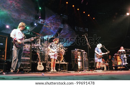 EAST RUTHERFORD, NEW JERSEY - AUGUST 3: The Grateful Dead in concert in East Rutherford, New Jersey, on Sunday, August 3, 1994.  From left is Phil Lesh, Bob Wier, Jerry Garcia,  and Vince Welnick. - stock photo