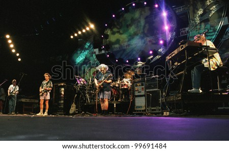 EAST RUTHERFORD, NEW JERSEY - AUGUST 3: The Grateful Dead in concert in East Rutherford, New Jersey, on Sunday, August 3, 1994.  From left is Phil Lesh, Bob Wier, Jerry Garcia, Micky Hart, and Vince Welnick. - stock photo