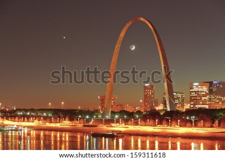 EAST ST. LOUIS, IL �¢?? OCTOBER 7: Venus and two-day-old crescent moon in conjunction over downtown St. Louis on Oct. 7, 2013. - stock photo