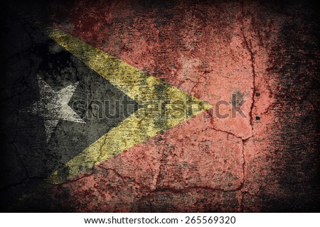 East Timor flag pattern on dirty old concrete wall texture ,retro vintage style - stock photo