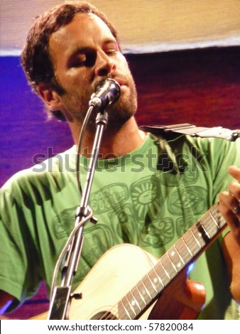 EAST TROY, WI - JUL. 24: Jack Johnson performs during their 2010 To The Sea tour in East Troy, Wisconsin at Alpine Valley Music Theater on July 24, 2010 in East Troy, MI - stock photo