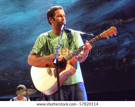 EAST TROY, WI - JUL. 24: Jack Johnson performs during their 2010 To The Sea tour in East Troy, Wisconsin at Alpine Valley Music Theater on July 24, 2010 in East Troy, MI. - stock photo