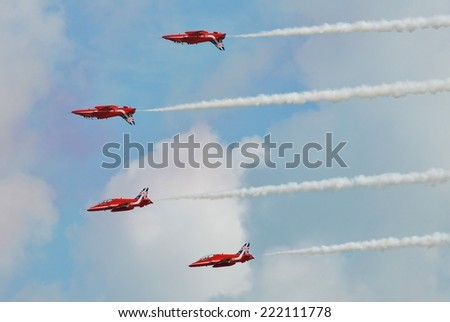 EASTBOURNE, ENGLAND - AUGUST 14, 2014: RAF aerobatic display team The Red Arrows perform at the annual Airbourne airshow. Formed in 1965, the team are in their 50th display season. - stock photo