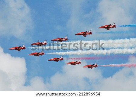 EASTBOURNE, ENGLAND - AUGUST 14, 2014: RAF aerobatic team The Red Arrows perform at the Airbourne airshow. Formed in 1965, the team are in their 50th display season. - stock photo