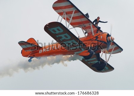 EASTBOURNE, ENGLAND - AUGUST 15, 2013: The Breitling wing walking display team perform at the Airbourne airshow. The team fly 1940s Boeing Stearman biplanes. - stock photo