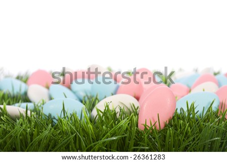 easter almonds candy on green grass - stock photo