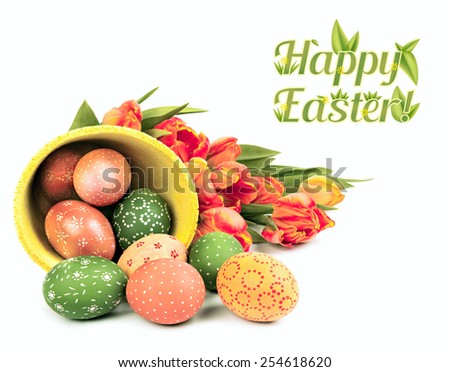"Easter arrangement with eggs and tulips, caption ""Happy Easter"" - stock photo"