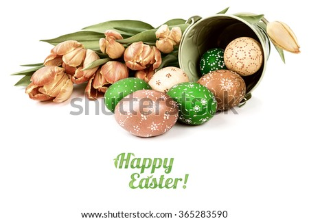 "Easter arrangement with eggs and tulips on white background, caption ""Happy Easter"". This image is toned. - stock photo"