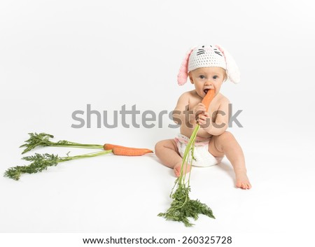 Easter Baby Bunny with Carrot - stock photo