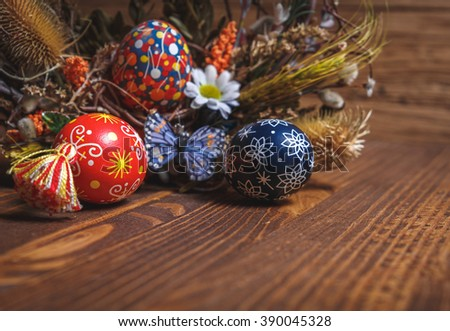 Easter background. colored Easter eggs and composition of dried flowers and plants. on wooden background. Easter theme. Happy Easter.  shallow depth of field.  - stock photo